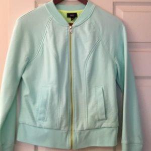 Mint front-zip sweatshirt with neon detail
